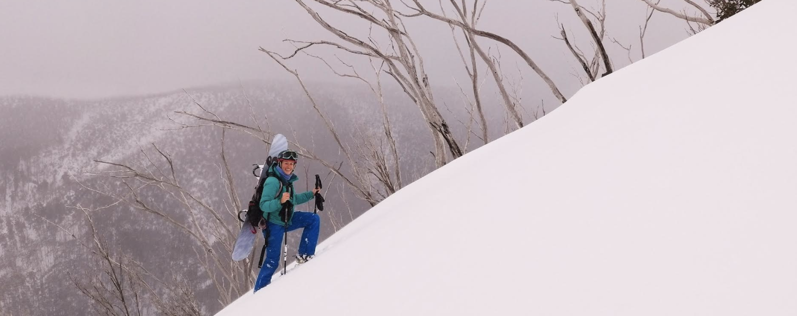 backcountry snowboarder and mother hiking