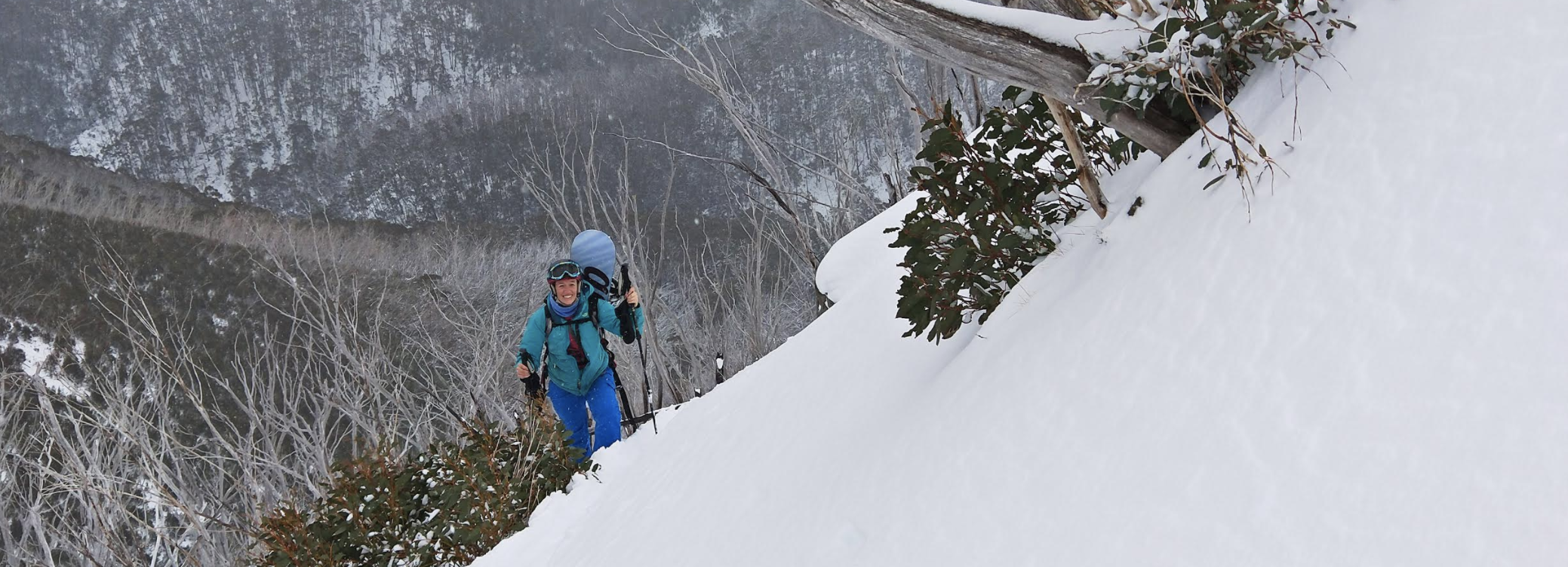 hiking and snowboarding in backcountry